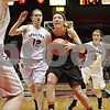 Rob Winner – rwinner@shawmedia.com<br /> <br /> DeKalb's Madelyne Johnson drives to the basket during the second quarter at the Convocation Center in DeKalb, Ill., Friday, Jan. 31, 2014. DeKalb defeated Sycamore, 46-42.