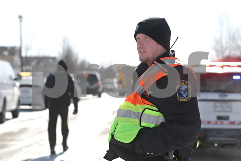 Rob Winner – rwinner@shawmedia.com<br /> <br /> A Northern Illinois University police officer blocks pedestrian traffic on the 1000 block of Quail Run in DeKalb, Ill., after a report of shots fired on Tuesday, Jan. 28, 2014.