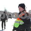 Rob Winner – rwinner@shawmedia.com<br /> <br /> A Northern Illinois University police officer blocks pedestrian traffic on the 1000 block of Quail Run in DeKalb, Ill., after a report of shots fired on Tuesday, Jan. 28, 2014.