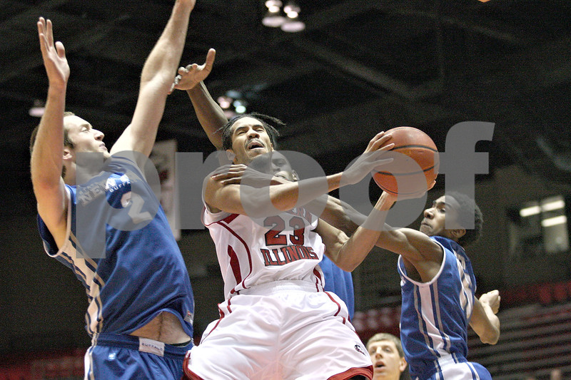 Monica Maschak - mmaschak@shawmedia.com<br /> Northern Illinois' Aaric Armstead gets stopped on his way to the basket in the first half against University at Buffalo at the Convocation Center on Saturday, January 25, 2014. The Huskies lost to the Bulls, 75-67.