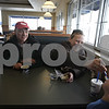 Rob Winner – rwinner@shawmedia.com<br /> <br /> (From left to right) Shane Smith, Noël Smith and Adam Alexander enjoy frozen custard at Culver's in Sycamore, Ill., Friday, Jan. 31, 2014. The Culver's Sycamore location has been updated with a dropped ceiling, new carpet, tables and seats as well as many other improvements.