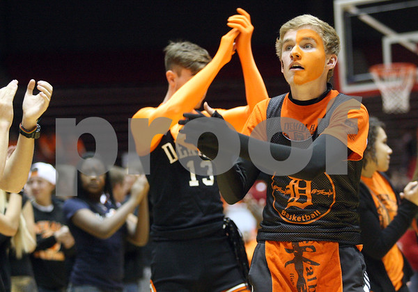 Monica Maschak - mmaschak@shawmedia.com<br /> Augi Jesmer, DeKalb senior, claps during a mass dance of the Cha Cha Slide during the Sycamore versus DeKalb girls and boys basketball games at the Convocation Center on Friday, January 31, 2014.