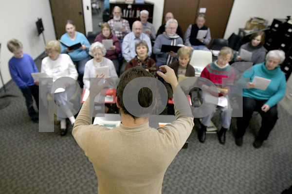 Monica Maschak - mmaschak@shawmedia.com<br /> Westminster Presbyterian Church choir practices for a concert to celebrate the church's 50th anniversary on Wednesday, January 29, 2014. The concert will be held on March 23.