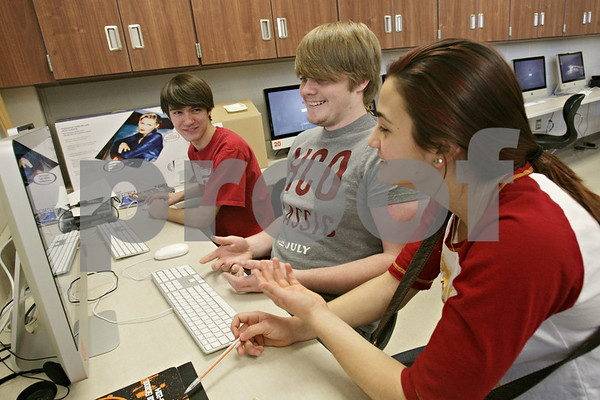 Rob Winner – rwinner@shawmedia.com<br /> <br /> (From left to right) Students including Joey Oxenvad, Jimmy Henry and Alison Morreale discuss their ideas while working on the DeKalb High School newspaper, The Barb Wire, during their journalism class on Thursday, Jan. 23, 2014.