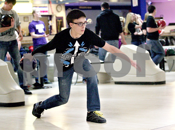 Monica Maschak - mmaschak@shawmedia.com<br /> Senior Kyle Bonnell bowls during practice at Four Seasons Bowl on Tuesday, January 28, 2014. Bonnell and teammate Alex Burchard will be heading to the State Bowling Tournament on Friday.