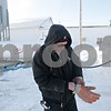 Rob Winner – rwinner@shawmedia.com<br /> <br /> Gary Metcalf of Conserv FS adjusts his safety gloves while filling a propane tank at a DeKalb business on Monday, Jan. 27, 2014.