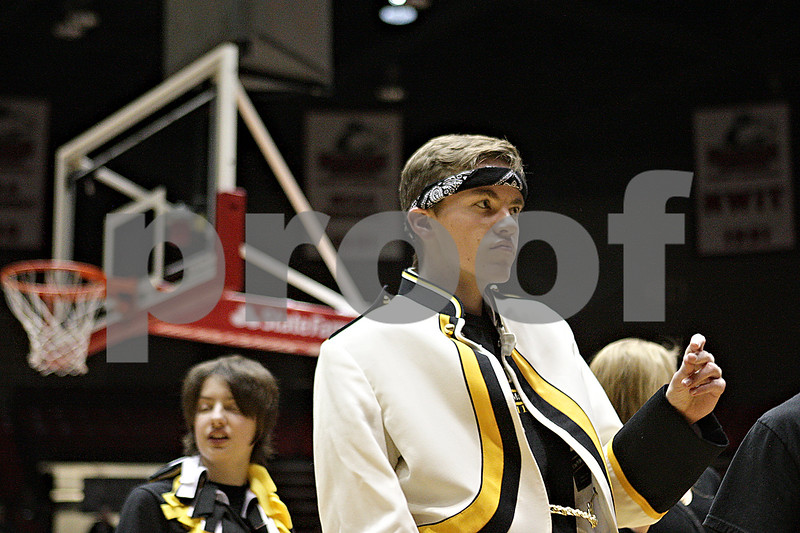 """Rob Winner – rwinner@shawmedia.com<br /> <br /> Sycamore junior Jake Pisarski dances to the """"Cha Cha Slide"""" during halftime at the Convocation Center in DeKalb, Ill., Friday, Jan. 31, 2014. DeKalb defeated Sycamore, 46-42."""