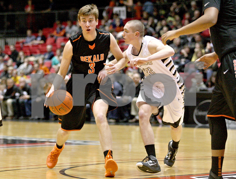 Monica Maschak - mmaschak@shawmedia.com<br /> DeKalb's Michael Pollack dribbles down the court during second quarter of the annual DeKalb versus Sycamore basketball game at the Convocation Center on Friday, January 31, 2014.
