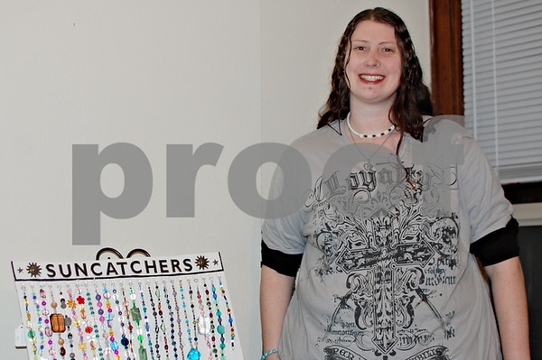 Debbie Behrends – dbehrends@shawmedia.com<br /> <br /> Jamie Stumbaugh, owner of Frostfire Designs, shows some of the jewelry and suncatchers she creates in her DeKalb home.