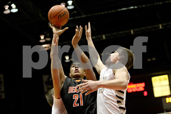 Monica Maschak - mmaschak@shawmedia.com<br /> DeKalb's Rudy Lopez Jr. shoots the ball during second quarter of the annual DeKalb versus Sycamore basketball game at the Convocation Center on Friday, January 31, 2014.