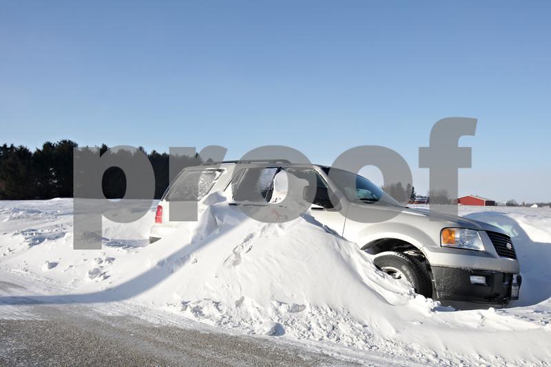 Rob Winner – rwinner@shawmedia.com<br /> <br /> A vehicle is seen stuck in a snowdrift on Somonauk Road in Sandwich Township on Monday, Jan. 27, 2014.