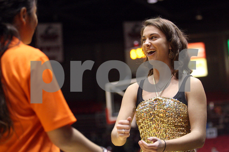 Monica Maschak - mmaschak@shawmedia.com<br /> Stephanie Cole, senior at Sycamore, reacts to winning a Rock, Paper, Scissors game during the Sycamore versus DeKalb girls and boys basketball games at the Convocation Center on Friday, January 31, 2014.