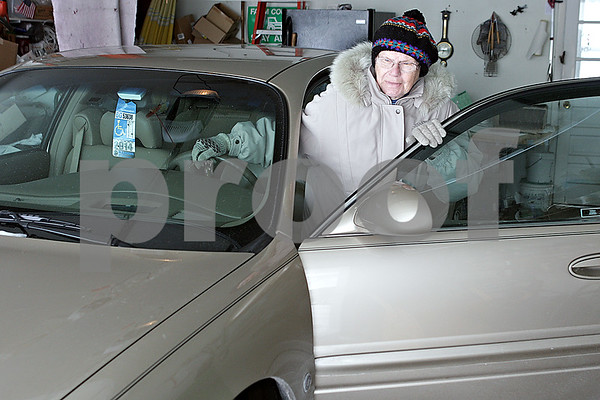 Rob Winner – rwinner@shawmedia.com<br /> <br /> DeKalb resident Dorothy Bierman, 86, gets into her Buick LeSabre before a drive on Friday, Jan. 24, 2014. Bierman has been driving for about 70 years.