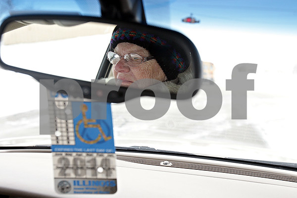 Rob Winner – rwinner@shawmedia.com<br /> <br /> Dorothy Bierman, 86, is seen in her rearview mirror while driving west on Fairview Drive in DeKalb, Ill., on Friday, Jan. 24, 2014. Bierman has been driving for about 70 years.