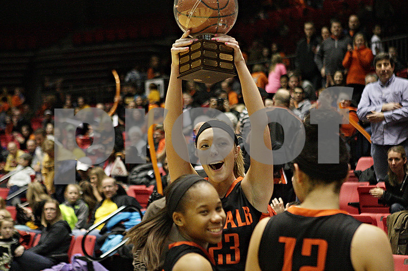 Rob Winner – rwinner@shawmedia.com<br /> <br /> DeKalb's Madelyne Johnson (23) celebrates with her teammates including Brittney Patrick (left) and Alexis Hammond after defeating Sycamore, 46-42, at the Convocation Center in DeKalb, Ill., Friday, Jan. 31, 2014.