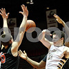 Monica Maschak - mmaschak@shawmedia.com<br /> Sycamore's Logan Wright loses the ball during first quarter of the annual DeKalb versus Sycamore basketball game at the Convocation Center on Friday, January 31, 2014.