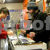 Monica Maschak - mmaschak@shawmedia.com<br /> Store Manager Alan Hubbard (right) prices out Magic: The Gathering cards that Konstantin Paraskevov, of Elburn, looks to trade at the Gaming Goat in DeKalb on Friday, January 24, 2014.
