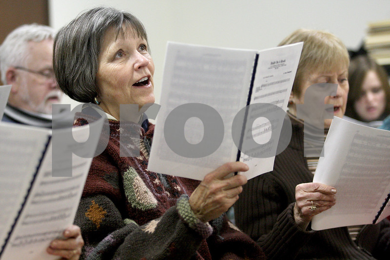 Monica Maschak - mmaschak@shawmedia.com<br /> Marlee Clymer sings during a choir practice for a concert to celebrate Westminster Presbyterian Church's 50th anniversary on Wednesday, January 29, 2014. The concert will be held on March 23.