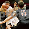 Monica Maschak - mmaschak@shawmedia.com<br /> Sycamore's Logan Wright gets the ball pushed to his face during first quarter of the annual DeKalb versus Sycamore basketball game at the Convocation Center on Friday, January 31, 2014.
