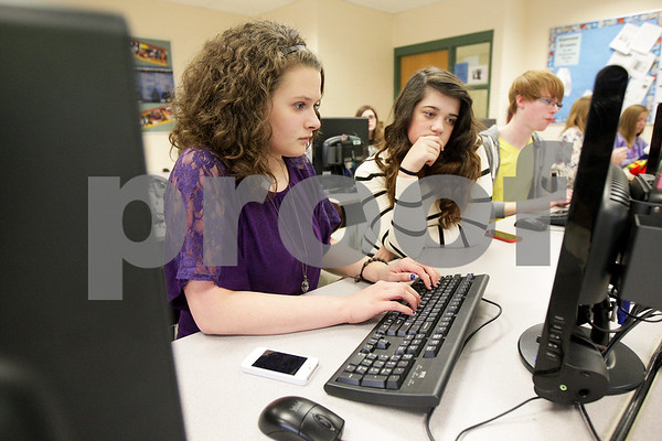 Monica Maschak - mmaschak@shawmedia.com<br /> Sophomore Danielle Grum (left) and freshman Alexandra Yetter work on a story during an after school meeting for Sycamore High School's student newspaper Spartan Voice on Wednesday, January 22, 2014. The Spartan Voice runs once a month.