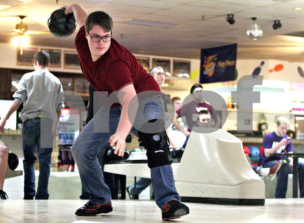 Monica Maschak - mmaschak@shawmedia.com<br /> Senior Alex Burchard  bowls during practice at Four Seasons Bowl on Tuesday, January 28, 2014. Burchard and teammate Kyle Bonnell will be heading to the State Bowling Tournament on Friday.