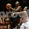 Rob Winner – rwinner@shawmedia.com<br /> <br /> DeKalb's Jasmine Malloy (left) looks to shoot as Sycamore's Julia Moll defends during the second quarter at the Convocation Center in DeKalb, Ill., Friday, Jan. 31, 2014. DeKalb defeated Sycamore, 46-42.