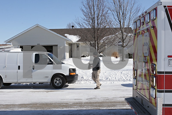 Rob Winner – rwinner@shawmedia.com<br /> <br /> A police officer is seen in front of a home on the 1000 block of Quail Run in DeKalb, Ill., after a report of shots fired on Tuesday, Jan. 28, 2014.