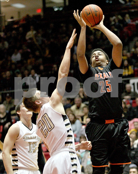 Monica Maschak - mmaschak@shawmedia.com<br /> DeKalb's Luke Davis III attmepts two points during second quarter of the annual DeKalb versus Sycamore basketball game at the Convocation Center on Friday, January 31, 2014.