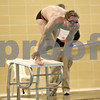 Monica Maschak - mmaschak@shawmedia.com<br /> Dylan Powers launches himself into the 50 yard freestyle event against Elgin on Thursday, January 30, 2014. DeKalb won the meet, 136-31.