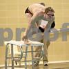 Monica Maschak - mmaschak@shawmedia.com<br /> Dylan Powers launches himself into the 50 yard freestyle event against Elgin on Thursday, January 30, 2014. DeKalb won the meet, 136-31.