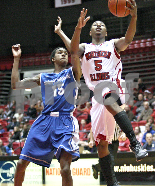 Monica Maschak - mmaschak@shawmedia.com<br /> Northern Illinois' Travon Baker takes it to the hoop in the first half against University at Buffalo at the Convocation Center on Saturday, January 25, 2014. The Huskies lost to the Bulls, 75-67.