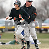 Beck Diefenbach  -  bdiefenbach@daily-chronicle.com<br /> <br /> DeKalb's Frank Petras (17) is congratulated by head coach Justin Keck as he rounds third base after hitting a home run during the third inning of the game against Sycamore at Sycamore Community Park in Sycamore, Ill., on Wednesday April 8, 2009.