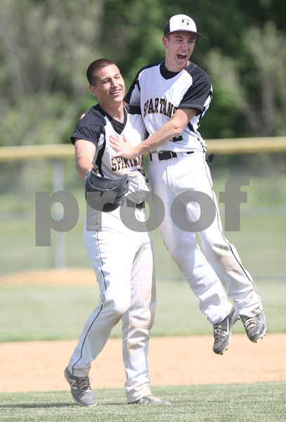 Monica Maschak - mmaschak@shawmedia.com<br /> Sycamore's Alexander Swedburg (right) jumps on Nathaniel Haacker after his game-winning home run in the tenth inning of the Hampshire regional final game against Burlington Central on Saturday, May 31, 2014. Sycamore won, 6-5.