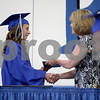 Monica Maschak - mmaschak@shawmedia.com<br /> Shannon Cronin accepts her diploma during the Hinckley-Big Rock graduation ceremony on Sunday, June 1, 2014.