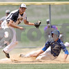 Monica Maschak - mmaschak@shawmedia.com<br /> Sycamore's Mark Skelley throws to first base after tagging third base in the fifth inning of the Hampshire regional final game against Burlington Central on Saturday, May 31, 2014. Sycamore won, 6-5, in 10 innings.