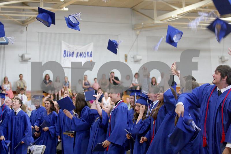 Monica Maschak - mmaschak@shawmedia.com<br /> The Hinckley-Big Rock class of 2014 tosses their caps after receiving their diplomas at the graduation ceremony on Sunday, June 1, 2014.