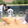 Monica Maschak - mmaschak@shawmedia.com<br /> Sycamore's Michael Swanberg (23) makes a catch in a close play at second base in the seventh inning of the Hampshire regional final game against Burlington Central on Saturday, May 31, 2014. Sycamore won, 6-5, in 10 innings.