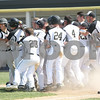 Monica Maschak - mmaschak@shawmedia.com<br /> Sycamore teammates celebrate Nathaniel Haacker's (left) game-winning home run in the tenth inning of the Hampshire regional final game against Burlington Central on Saturday, May 31, 2014. Sycamore won, 6-5.