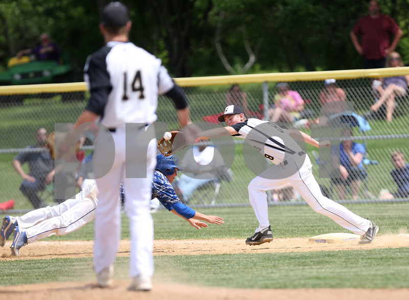 Monica Maschak - mmaschak@shawmedia.com<br /> Sycamore's Cooper Vinz catches Colan Treml's pick-off attempt in the seventh inning of the Hampshire regional final game against Burlington Central on Saturday, May 31, 2014. Sycamore won, 6-5, in 10 innings.