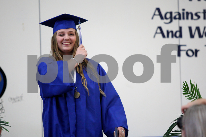 Monica Maschak - mmaschak@shawmedia.com<br /> Katherine Hall moves her tassel during the Hinckley-Big Rock graduation ceremony on Sunday, June 1, 2014.