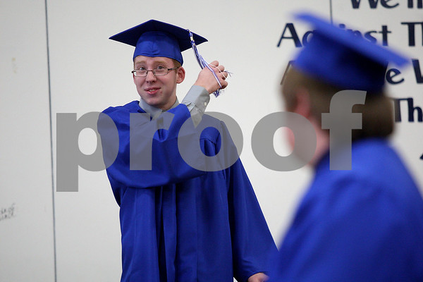 Monica Maschak - mmaschak@shawmedia.com<br /> Luke Bish moves his tassel from from right to left during the Hinckley-Big Rock graduation ceremony on Sunday, June 1, 2014.