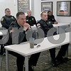 Monica Maschak - mmaschak@shawmedia.com<br /> DeKalb and Northern Illinois University police listen in on a day-shift roll call meeting at the DeKalb Police Department on Thursday, March 6, 2014. These meetings happen three times a day.