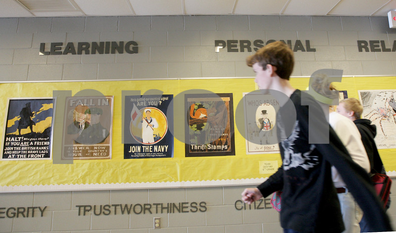 Monica Maschak - mmaschak@shawmedia.com<br /> Mark Mannebach's 8th grade students have replicated WW I propaganda posters that are hanging in Sycamore Middle School's hallways. Mannebach makes the poster assigment part of his WW I lesson to show students how posters were important as a mass media tool even before radio.