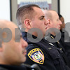 Monica Maschak - mmaschak@shawmedia.com<br /> Officer Jonathan Jursich sits among DeKalb and Northern Illinois University police during a day-shift roll call meeting at the DeKalb Police Department on Thursday, March 6, 2014.