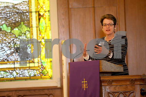 Monica Maschak - mmaschak@shawmedia.com<br /> Bishop Sally Dyck speaks to participants during the World Day of Prayer at First United Methodist Church in DeKalb on Friday, March 7, 2014. Seven DeKalb churches participated in this year's event prepared by Christian women in Egypt.