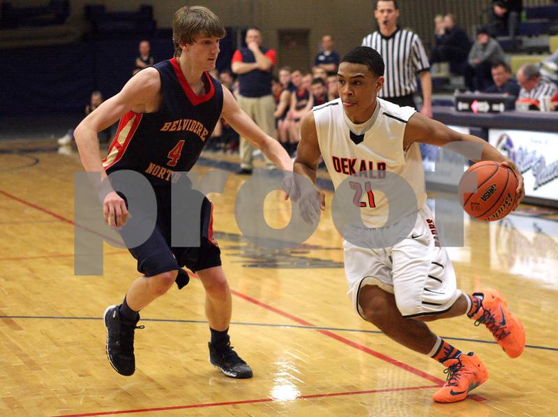 Monica Maschak - mmaschak@shawmedia.com<br /> DeKalb's Rudy Lopez Jr. goes one on one with a defender in the fourth quarter of the Class 4A Regional quarterfinal game against Belvidere North on Monday, March 3, 2014. DeKalb won, 82-71.