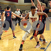 Monica Maschak - mmaschak@shawmedia.com<br /> DeKalb's Luke Davis III crashes into a defender in the first quarter of the Class 4A Regional quarterfinal game against Belvidere North on Monday, March 3, 2014. DeKalb won, 82-71.