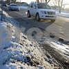 Monica Maschak - mmaschak@shawmedia.com<br /> Drivers avoid a large pot hole (bottom right) on North First Street in DeKalb just north of the intersection with Dresser Road.