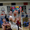 Monica Maschak - mmaschak@shawmedia.com<br /> Sycamore's Devin Mottet attempts two points in the second quarter of the class 3A semifinal regional game against Montini Catholic on Tuesday, March 4, 2014. Sycamore won, 83-49.
