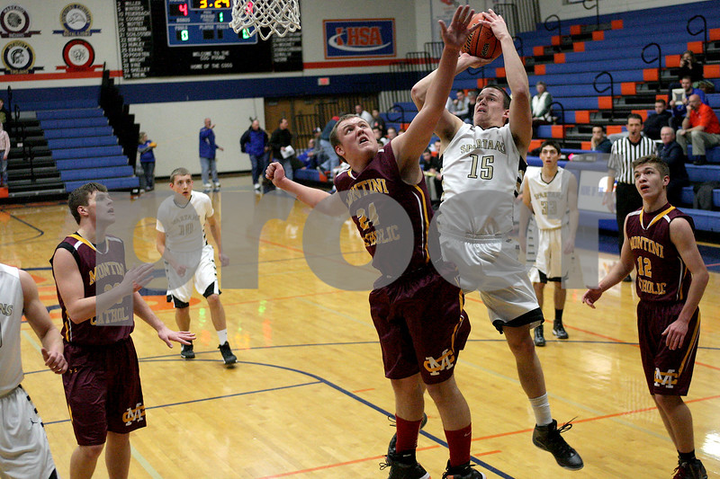 Monica Maschak - mmaschak@shawmedia.com<br /> Sycamore's Devin Mottet shoots the ball in the first quarter of the class 3A semifinal regional game against Montini Catholic on Tuesday, March 4, 2014. Sycamore won, 83-49.